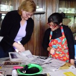 Mentor Cathy, and student, Gaby learn block printing techniques.