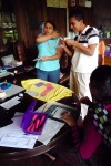 Evelyn, Orling, and Josefa practice block printing on fabric