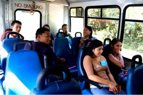 Students take the bus to visit their client's establishment.